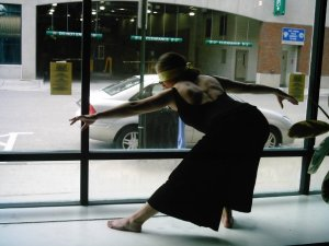 Here's Anna B when she was a professional dancer.  I love this picture because she allows us to do things to her like as her to dance blindfolded in a store window downtown.  Also, if I had a picture of my back muscles looking like that I'd want it to be used in my profile always.